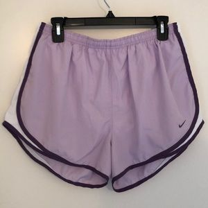 Lavender Nike running shorts, dry fit.